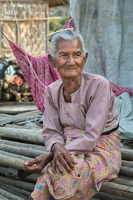 A beautiful older woman living among the bamboo workers' area in Mandalay.