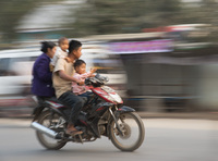 A motorbike for four in Mandalay.